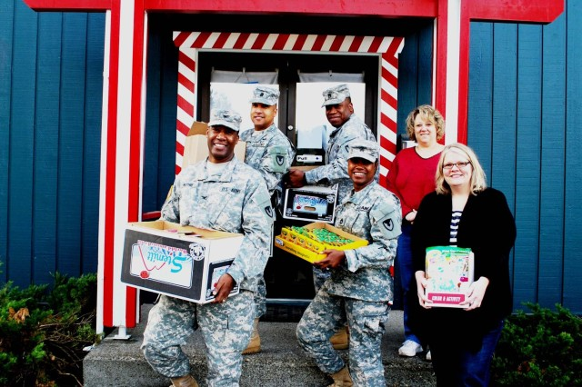 Soldiers of the 404th Army Field Support Brigade at Joint Base Lewis-McChord, Wash., are bringing Christmas joy to children as part of the Santa's Castle program.