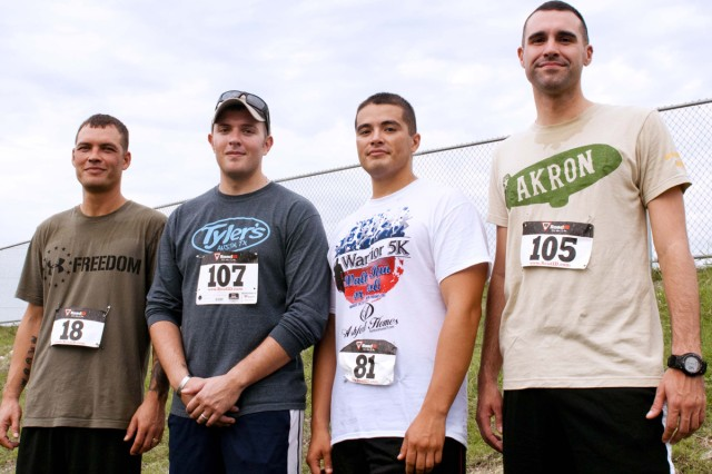 HARKER HEIGHTS, Texas -- Staff Sgt. Randy DeMoss, Sgt. Paul Podhorn, Staff Sgt. Andrew Valadez and Sgt. Corey Dwyer, all cavalry scouts with the 1st Cav. Div., stand together after the Warrior 5K Walk, Run or Roll fundraiser at Harker Heights Community Park, Aug. 24. The fundraiser, which was organized by RE/MAX RedZone of Harker Heights, was one of many events the Texas Sentinels Foundation put together to help the Podhorns. (US Army Photo by Sgt. Samuel Northrup, 7th Mobile Public Affairs Detachment)