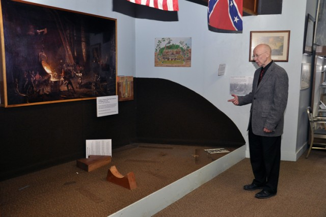 Watervliet Arsenal museum Curator Robert Pfeil looks over an exhibit area after artifacts were removed by the Center of Military History.  The arsenal believes that CMH will reopen the museum in one to two years, but as a gallery.