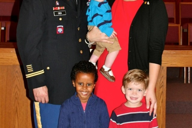 "Maj. Marshall Coen (left), a Killeen, Texas, native and chaplain for the 1st ""Ironhorse"" Brigade Combat Team, 1st Cavalry Division, smiles for a family photo with his wife, Jill (right), and sons, Silas (lower left), Jude, (lower right), and baby Ira (center),after his promotion ceremony, Dec. 3, at Fort Hood, Texas. ""My father modeled for me what was important which are faith, family, then career,"" Marshall said. ""I see some of the sacrifices that are required, and I understand what's important."" (Photo courtesy of Maj. Marshall Coen, 1st BCT, 1st Cav. Div.)"