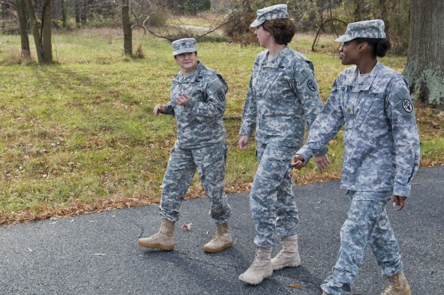 Army public health nurses Col. Heidi Warrington, Maj. Kari Bruley and Maj. Lakisha Flagg walk as they talk about upcoming work.