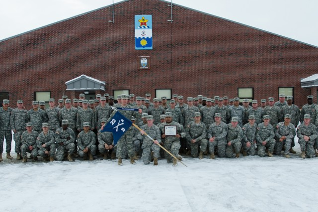 Soldiers of D Company, 2nd Battalion, 22nd Infantry Regiment, 1st Brigade Combat Team, gather Friday with the 10th Mountain Division (LI) and 2-22 Infantry command teams during an awards ceremony recognizing them for exceptional performance in marksmanship. In addition to the marksmanship streamer, D Company, 2-22 Infantry, received a hand-written plaque from the commanding general acknowledging them as the first unit to achieve this task in division history.