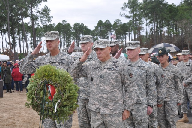 Col. Stephen Yackley, Fort Jackson deputy commanding officer, and Command Sgt. Maj. Kevin Benson, Fort Jackson installation command sergeant major, lead a team of Fort Jackson Soldiers in saluting the Army memorial wreath during the Wreaths Across America ceremony Saturday at the Fort Jackson National Cemetery. The ceremony and wreath-laying were part of an annual event held nationwide to remember veterans during the holiday season.