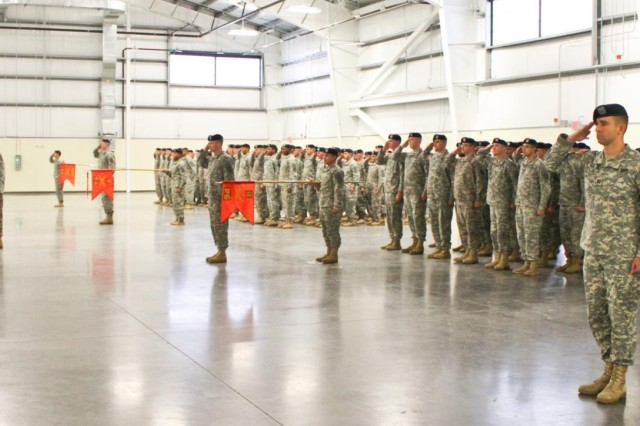Soldiers with 1st Battalion, 94th Field Artillery Regiment, 17th Fires Brigade, 7th Infantry Division, present arms in formation during a casing of the colors ceremony at North Lewis, Joint Base Lewis McChord, Wash., Dec. 12. (U.S. Army photo by Spc. Nathan Goodall, 17th Fires Bde. Public Affairs)
