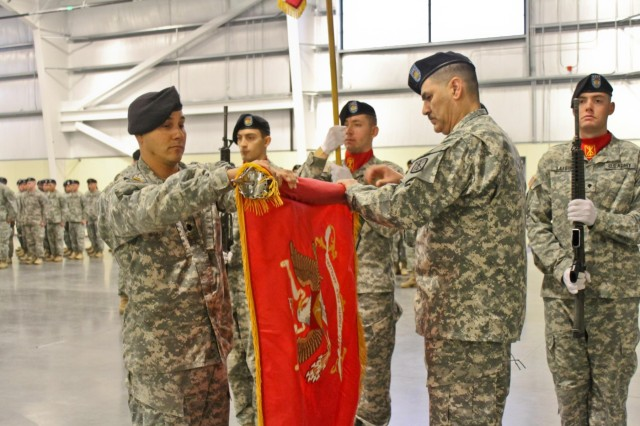 Lt. Col. Luis M. Rivera, the commander for 1st Battalion, 94th Field Artillery Regiment, 17th Fires Brigade, 7th Infantry Division, cases the battalion colors with Command Sgt. Maj. Cesar J. Zertuche, the 1-94 FA command sergeant major, during a casing of the colors ceremony at North Lewis, Joint Base Lewis McChord, Wash., Dec. 12. (U.S. Army photo by Spc. Nathan Goodall, 17th Fires Bde. Public Affairs)