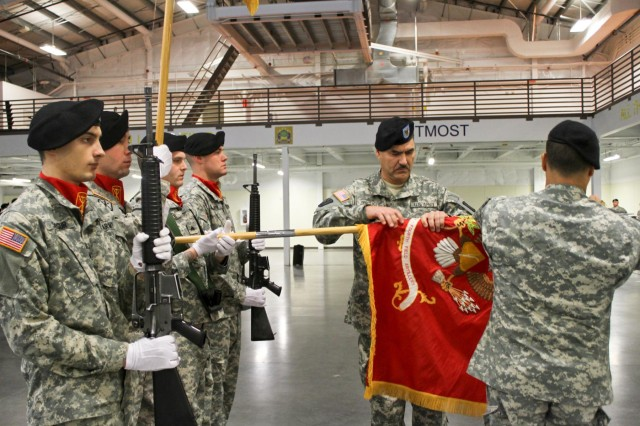 Command Sgt. Maj. Cesar J. Zertuche, the command sergeant major for 1st Battalion, 94th Field Artillery Regiment, 17th Fires Brigade, 7th Infantry Division, cases the battalion colors with Lt. Col. Luis M. Rivera, the 1-94 FA commander, during a casing of the colors ceremony at North Lewis, Joint Base Lewis McChord, Wash., Dec. 12. (U.S. Army photo by Spc. Nathan Goodall, 17th Fires Bde. Public Affairs)