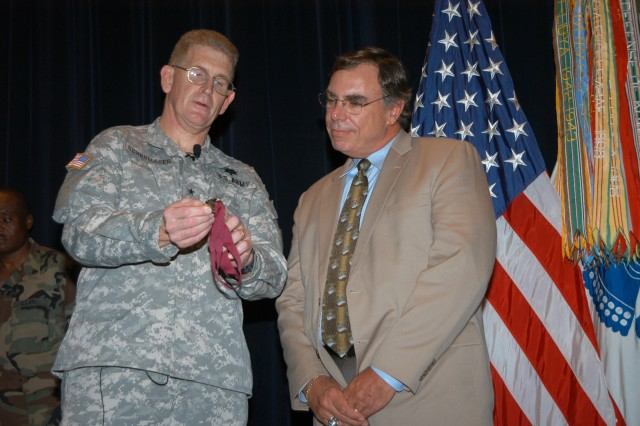 Dr. Andy Young of the U.S. Army Research Institute of Environmental Medicine receives the Order of Military Medical Merit.