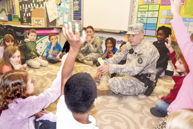 Staff Sgt. Kevin Lipinski, 212th Military Police Detachment, Headquarters Battalion, talks about respect with students in Jocelyn Thompson's first-grade class at Fort Belvoir Elementary School Dec. 12 as part of the Character Counts program.