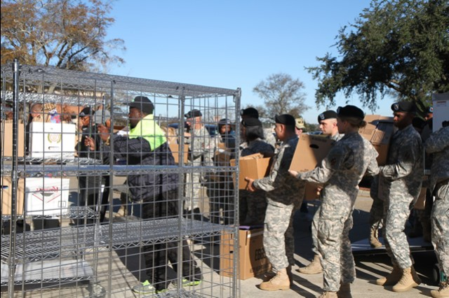 Soldiers with the 3rd Sustainment Brigade, 3rd Infantry Division, help load boxes full of gift bags to hand out to veterans at the Carl Vinson Medical Center, Dec. 12, in Dublin, Ga. The 3rd Infantry Division, along with Fort Stewart's Medical Activity supports the Carl Vinson Medical Center annually, spreading holiday cheer and to show the veterans their appreciation.