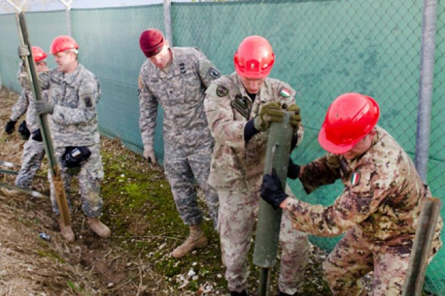 "US and Italian combat engineers place and remove posts during one of the segments of the Sapper Stakes in Vicenza, Italy. Castle Company "" Company A, 173rd Brigade Special Troops Battalion, of the 173rd Infantry Brigade Combat Team (Airborne) "" put its combat engineers to the test at the end of November during the unit's first Sapper Stakes competition on both Caserma Del Din and Caserma Ederle in Vicenza, Italy."