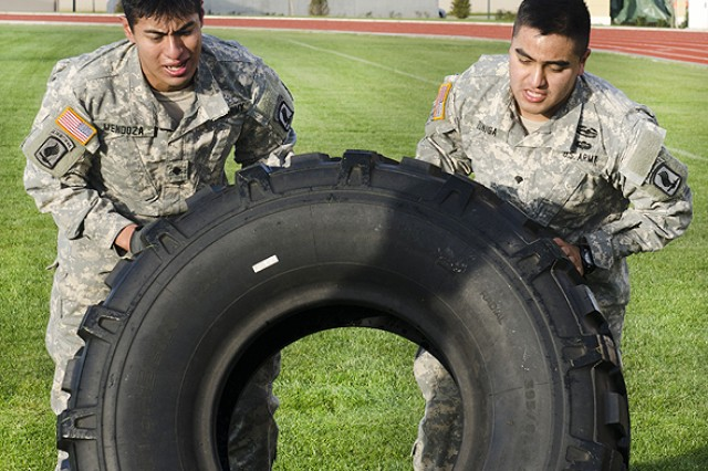 "Two Sky Soldiers undertake the tire flip challenge during the Sapper Stakes in Vicenza, Italy. Castle Company "" Company A, 173rd Brigade Special Troops Battalion, of the 173rd Infantry Brigade Combat Team (Airborne) "" put its combat engineers to the test at the end of November during the unit's first Sapper Stakes competition on both Caserma Del Din and Caserma Ederle in Vicenza, Italy."