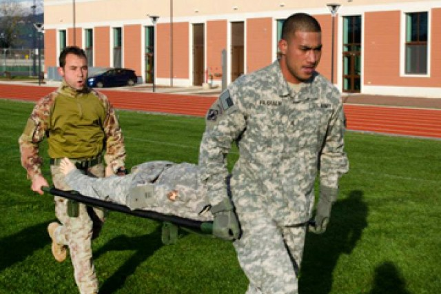 "An Italian and an American combat engineer run during a litter carry segment of the Sapper Stakes. Castle Company "" Company A, 173rd Brigade Special Troops Battalion, of the 173rd Infantry Brigade Combat Team (Airborne) "" put its combat engineers to the test at the end of November during the unit's first Sapper Stakes competition on both Caserma Del Din and Caserma Ederle in Vicenza, Italy."