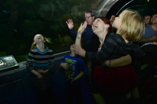 "First Lt. Nick Aldridge, executive officer with the Minnesota National Guard's 850th Horizontal Engineer Company, surprised his family as ""Scuba Claus"" at the Mall of America's Sea Life Aquarium in Bloomington, Minn., Dec. 22, 2013, after returning to the United States from a deployment to Afghanistan. The 850th repaired and maintained convoy and supply routes, cleared mine fields, improved drainage, deconstructed non-essential bases and built a resiliency center, a gym and multiple guard towers during their eight-month deployment to Afghanistan."