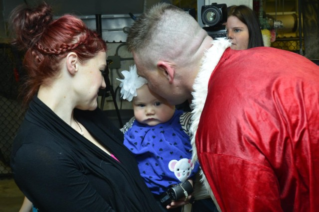 "First Lt. Nick Aldridge, executive officer with the Minnesota National Guard's 850th Horizontal Engineer Company, meet his 7-month-old daughter for the first time when he surprised his family as ""Scuba Claus"" at the Mall of America's Sea Life Aquarium in Bloomington, Minn., Dec. 22, 2013, after returning to the United States from a deployment to Afghanistan. The 850th repaired and maintained convoy and supply routes, cleared mine fields, improved drainage, deconstructed non-essential bases and built a resiliency center, a gym and multiple guard towers during their eight-month deployment to Afghanistan."