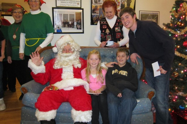 Santa sits with Isabelle, Ryan, and Matthew Clark, children of Picatinny Soldier Lt. Col. Phil Clark, during the Veterans of Foreign Wars Post 2519's 4th Annual Children's Christmas Party Dec. 15.