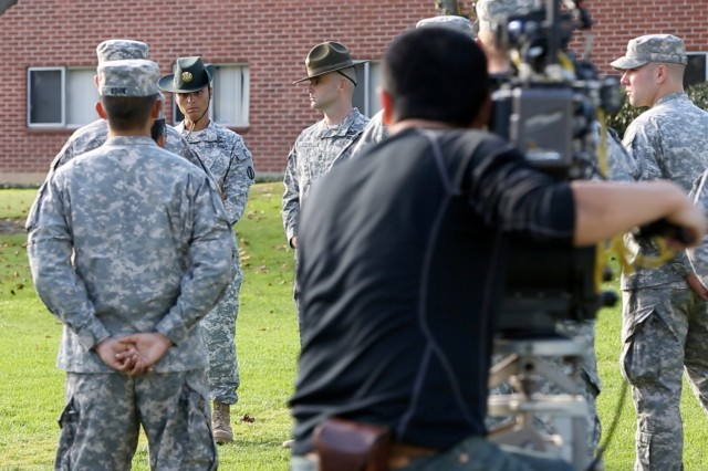 Staff Sgt. Amber Jones (front left), a drill sergeant leader in the U.S. Army, takes part in the filming of the latest series of Army television advertising in Long Beach, Calif.