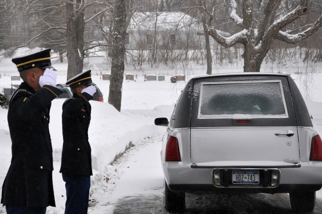 New York Army National Guard Spc. Christopher Roderiguez and Pvt. Shelbi Vanderbogart salute as the remains of Army veteran Harold Smith arrive for graveside services in Hudson, N.Y., Dec. 17, 2013. Smith's funeral was one of 9,735 that the New York Military Forces Honor Guard's 35 full-time and 135 part-time members performed for families across New York, as of Dec. 23.
