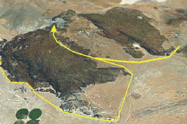 Sam Hunter's years of research on petroglyphs and other artifacts around and on Black Mountain north of Hinkley, Calif., has led him to theorize that they memorialize a great battle between Uto-Aztecan and Hokan tribes thousands of years ago. The yellow lines and arrow on the aerial map depict the route and progress of the attacking Hokan warriors.