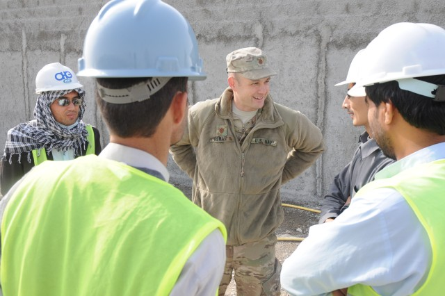 Lieutenant Commander Jared Asman (center), the Afghan Hand who serves as the Kandahar international airport development advisor, checks on the progress of the entry control point and police barracks under construction at the airport. (U.S. Army photo by 1st Sgt. Mary L. Williams)
