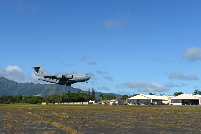 A C-17 Globemaster III aircraft touches down, Dec. 16, in an exercise to demonstrate the ability of the Air Force and Army to rapidly deploy. The runway, a National Historic Landmark dating back to the dawn of aviation, is shorter than the one at Joint Base Pearl Harbor-Hickam and is mostly used today for helicopters and smaller, propeller driven aircraft.
