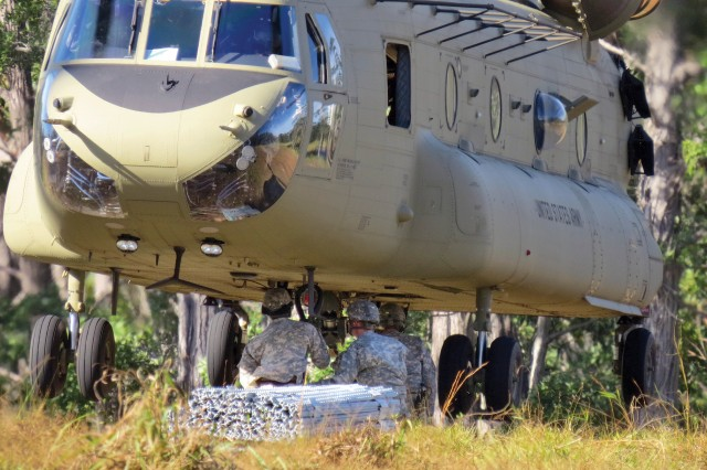 A 1,000-pound bundle of steel fencing is sling-loaded to a CH-47 Chinook to airlift the material from Schofield Barracks, Hawaii, to the summits of the Ko'olau mountain range on Oahu, Hawaii, Dec. 5, 2013.