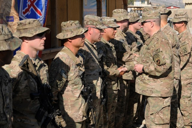"""LAGHMAN PROVINCE, Afghanistan """" U.S. Army Lt. Gen. Mark Milley, commander, International Security Assistance Force Joint Command, presents coins to 4th Brigade Combat Team, 10th Mountain Division, Task Force Patriot Soldiers at Forward Operating Base Gamberi, Dec. 25, 2013. Milley spent part of his Christmas Day with Soldiers showing them what sacrificing their holiday with their families in order to aid the mission in Afghanistan meant to him. (U.S. Army Photo by Sgt. Eric Provost, Task Force Patriot PAO)"""