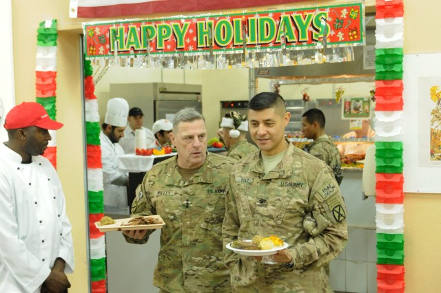 """LAGHMAN PROVINCE, Afghanistan """" U.S. Army Lt. Gen. Mark Milley (left), commander, International Security Assistance Force Joint Command, and Col. Mario Diaz (right), commander, 4th Brigade Combat Team, 10th Mountain Division, Task Force Patriot, grab Christmas lunch from the dining facility at Forward Operating Base Gamberi, Dec. 25, 2013. Milley spent most of his day in 4th Bde.'s area of operations visiting with Task Force Patriot's troops for the holiday. (U.S. Army Photo by Sgt. Eric Provost, Task Force Patriot PAO)"""