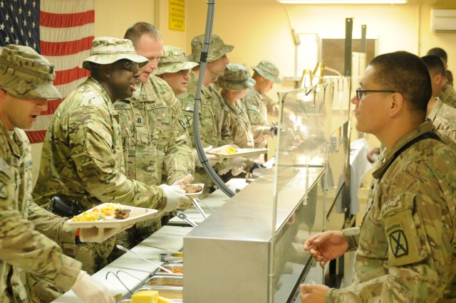 """LAGHMAN PROVINCE, Afghanistan """" U.S. Army leaders with 5th Battalion, 25th Field Artillery Regiment, serve Soldiers Christmas dinner at Forward Operating Base Mehtar Lam's dining facility Dec. 25, 2013. Army leaders across Afghanistan found different ways to get into the holiday spirit, each finding their own special gifts they can give to their Troops. 5th Bn. is a part of 4th Brigade Combat Team, 10th Mountain Division, Task Force Patriot. (U.S. Army Photo by Sgt. Eric Provost, Task Force Patriot PAO)"""
