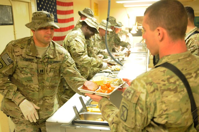 "LAGHMAN PROVINCE, Afghanistan "" U.S. Army leaders with 5th Battalion, 25th Field Artillery Regiment, 4th Brigade Combat Team, 10th Mountain Division, Task Force Patriot, serve Christmas dinner to the battalion's Soldiers at Forward Operating Base Mehtar Lam's dining facility Dec. 25, 2013. Leaders serveing their troops on holidays like Christmas and Thanksgiving is an Army tradition that shows how much the command appreciates the Soldier's tireless efforts. (U.S. Army Photo by Sgt. Eric Provost, Task Force Patriot PAO)"
