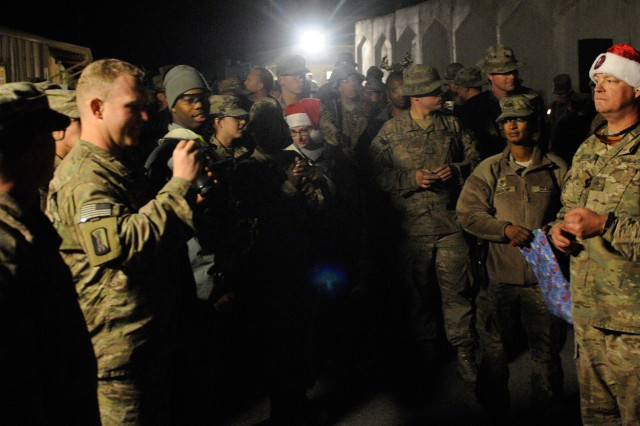 """NANGARHAR PROVINCE, Afghanistan """" U.S. Army Soldiers stationed at Forward Operating Base Fenty take part in the base's USO Christmas Raffle the night of Dec. 25, 2013, competing for prizes like a bicycle, television, IPad, and others. Events like this provide a welcome respite for deployed service members and offer them a way to celebrate the holidays even though they're away from their families. (U.S. Army Photo by Sgt. Eric Provost, Task Force Patriot PAO)"""