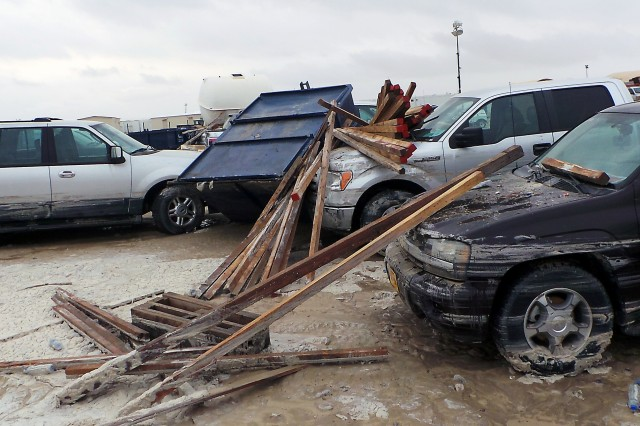 The flash flood floated dumpsters Nov. 19, 2013, at Camp Arifjan, Kuwait, into the parking lot between and around vehicles.