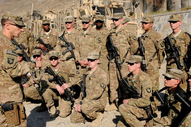Lt. Col. Scott Kirkpatrick (left), commander, 2nd Battalion, 506th Infantry Regiment, 4th Brigade Combat Team, 101st Airborne Division (Air Assault), gathers the members of 1st Platoon, of the storied Easy Company, to extend his gratitude to them for their hard work while on deployment in Afghanistan at Forward Operating Base Wright, Dec. 18, 2013. Their mission will end at Wright, assisting in force protection for 4th Brigade Combat Team, 10th Mountain Division, after having completed their missions in Khost Province.
