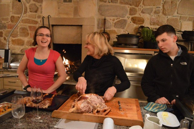 From left to right: Pvt.2 Amber Regalia, Irene Schleicher and Spc. Travis Williams put the finishing touches on Christmas dinner in Kemnath, Dec. 24.