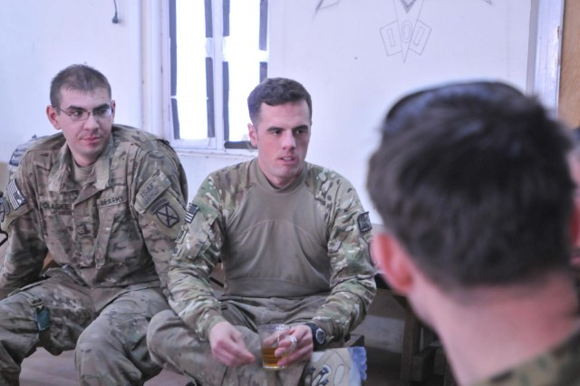 Capt. Michael Peverada (right), intelligence officer and 1st Lt. Nicolas Polaske (left), fire support officer both with 2nd Battalion, 30th Infantry Regiment, sit with their 4th Brigade, 201st Afghan National Army counterparts, at Forward Operating Base Connolly, Afghanistan, Dec. 29, 2013, to discuss the status of the mission resulting to build three new checkpoints in Khugyani district, and set the conditions for more secure elections in April.