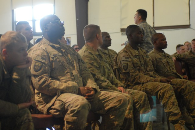 Demobilizing Soldiers from the 1103rd Military Police Detachment, Ky. National Guard, the 3-49th Agra-Business Development Team, S.C. National Guard, and the Ill. National Guard are briefed on the demobilization process by Lt. Col. Samuel Rodriguez, 3-314th Field Artillery Regiment battalion commander. (U.S. Army photo by Capt. Kelvin Scott, 72nd Field Artillery Brigade Public Affairs)