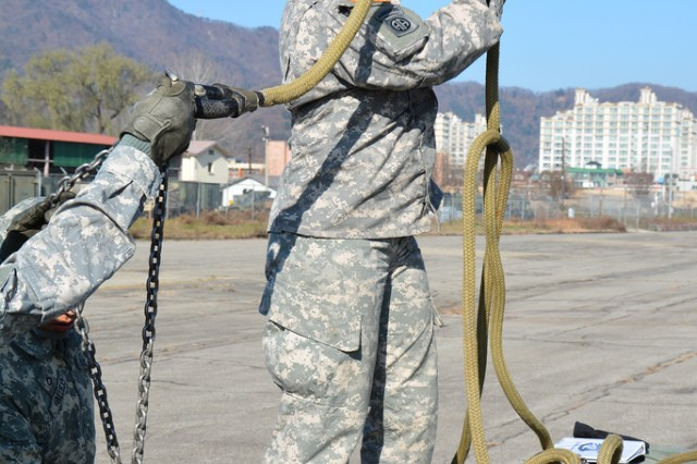 "CAMP MOBILE, South Korea "" Sgt. 1st Class Maria Estrada, from Fresno, Calif., a maintenance supervisor assigned to Headquarters and Headquarters Company, 70th Brigade Support Battalion, 210th Fires Brigade, 2nd Infantry Division inspects the sling legs before sling-load training begins Nov. 22, 2013 on Camp Mobile, South Korea. The sling-load training improves the unit's readiness to ""Fight Tonight"" by moving military equipment through the air to remote locations."