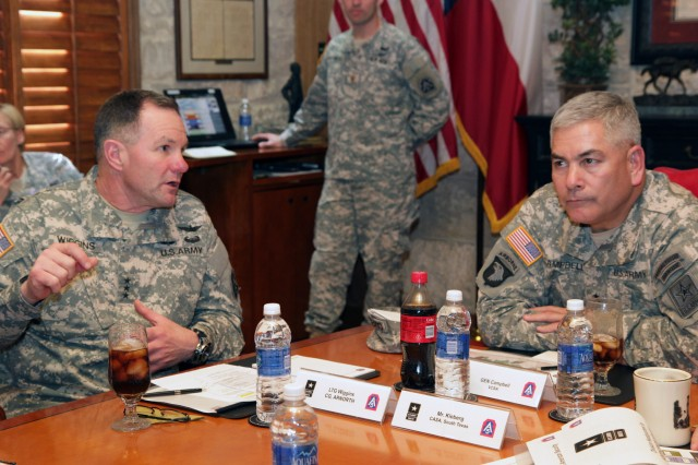 Gen. John Campbell, the vice chief of staff of the Army, views a presentation as Lt. Gen. Perry Wiggins, commanding general U.S. Army North and senior commander Fort Sam Houston and Camp Bullis, speaks Jan. 3 about the role of Army North in defense of the Homeland.  (Photo by Sgt. Lee Ezzell, Army North PAO)