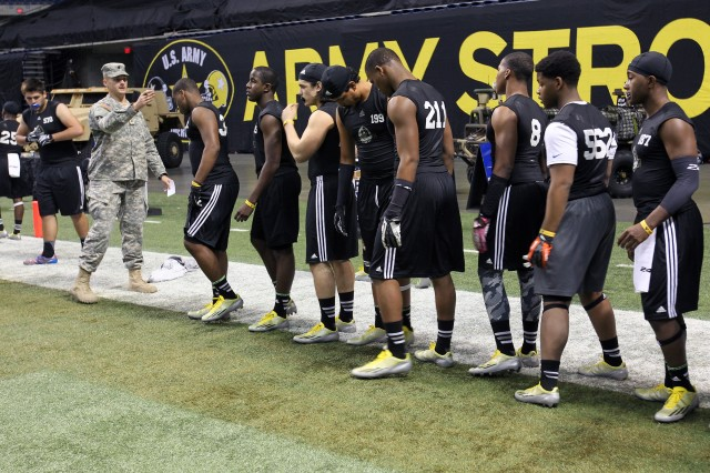 Army ROTC Cadet Travis Watson directs high school football players at the Army National Combine, Jan. 3, 2014, at the Alamodome in San Antonio. Watson is one of 20 cadets nationwide who was selected to act as a marshal at the combine.