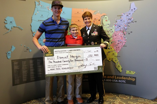 Brig. Gen. Maria Gervais, deputy commander, U.S. Army Cadet Command and Fort Knox, Ky., presents an #ArmyROTC scholarship check to Daniel Harger (left) as Daniel's brother, Michael, looks on, Jan. 4 in San Antonio.   The scholarship, in the amount of $172,000, will pay for Daniel's tuition at Texas Christian University. When he graduates, he will commission as an Army second lieutenant.  Gervais presented the scholarship during her remarks at the National Collegiate Scouting Association breakfast held during the Army All-American Bowl week.