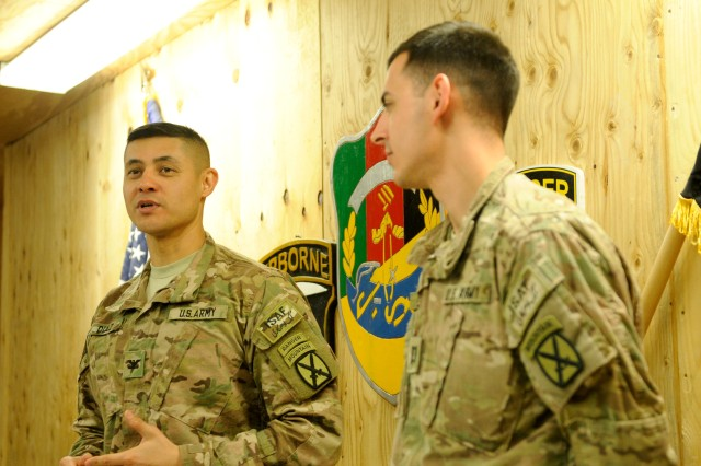 "LAGHMAN PROVINCE, Afghanistan "" U.S. Army Col. Mario Diaz (left), commander, 4th Brigade Combat Team, 10th Mountain Division, Task Force Patriot, praises the work ethic and character of plans officer Capt. David Wilson (right), Jan. 3, 2014, at Forward Operating Base Gamberi, before presenting him with his end of tour awards. Wilson is leaving Afghanistan to attend Ranger School. (U.S. Army Photo by Sgt. Eric Provost, Task Force Patriot PAO)"