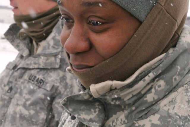 Snowflakes gather on the eyelashes of Staff Sgt. Crystal Washington, a Jacksonville, N.C., native, currently a unit supply specialist with 472nd Military Police Company, 793rd Military Police Battalion, as she participates in her first Arctic winter training course that teaches soldiers how to stay warm and safe during Alaska's cold winter temperature and how to use the equipment properly to keep everything working and avoid cold weather injuries. (U.S. Army photo by Staff Sgt. Trish McMurphy, USARAK Public Affairs)
