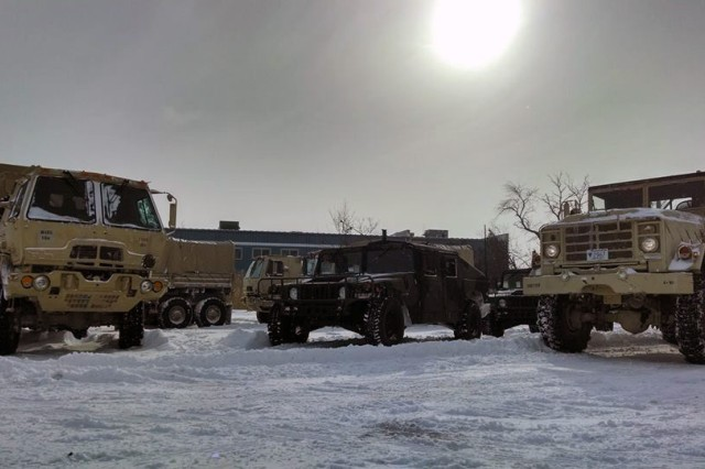 Soldiers of the 1166th Transportation Company from Worcester, Mass., prepare their Light Medium Tactical Vehicles for tide and flood checks as part of the Guard's response to the New Year's Winter Storm Hercules, Jan. 3, 2014.