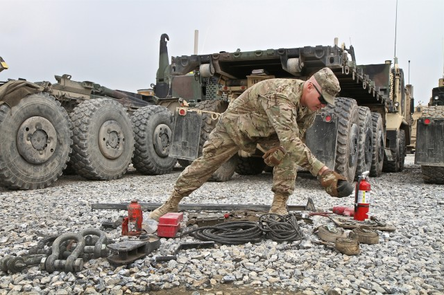 Spc. Lyle Carter, with the 396th Transportation Company, 157th Combat Sustainment Support Battalion, organizes equipment while taking inventory for a palletized load system at Bagram Airfield, Afghanistan.