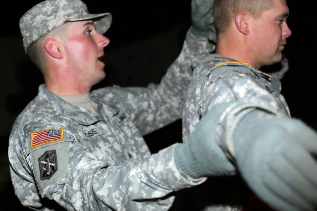 """FORT SILL, Okla. -- A Soldier searches a """"detainee"""" during the 214th Fires Brigade Leader Gut Check competition Feb. 7, 2013, at Contingency Operations Location Sanders at Fort Sill. The """"Leader Brigade"""" conducted the competition for its junior enlisted Soldiers as a training and morale event. The brigade plans to hold an officer version of Gut Check later this year."""