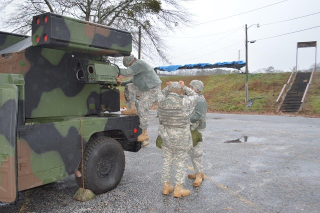 Soldiers of the South Carolina National Guard's 2nd Battalion, 263rd Air Defense Artillery Regiment braved the cold weather and precipitation to conduct march order and emplacement crew drills during the unit's weekend training event recently, while observer-coach/trainers evaluated all crews on their Air Defense tasks in relation to the unit's upcoming mission in the National Capital Region.  (Photo by Sgt. First Class Marlon V. Miguel, 1st Battalion, 362nd Air Defense Artillery Regiment, 5th Armored Brigade, Division West)