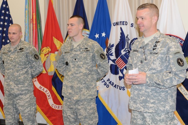 Joint Force Headquarters - National Capital Region and the U.S. Army Military District of Washington Command Sgt. Maj. David O. Turnbull speaks about the outstanding performance of Sgt. (promotable) Brian J. Gougler and Spc. (promotable) Will D. Marshall, JFHQ-NCR/MDW movement coordinators, during the beginning of their promotion ceremony held at Fort Lesley J. McNair, Jan. 6, 2014.