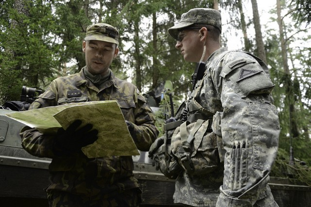 Capt. Petr Liska of the Czech Army's 1st Company, of the 72nd Mechanized Brigade briefs  Capt. Ryan Nugent of Joint Multinational Readiness Center  at Hohenfels, Germany during exercise Combined Resolve, Nov. 19, 2013.