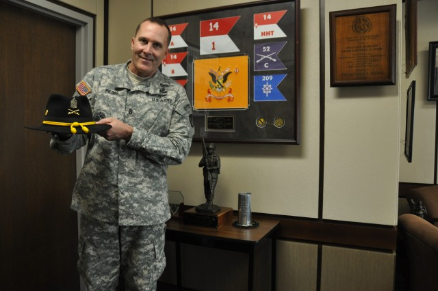 A 31-year Army career comes with many mementos that tell a Soldier's story. Command Sgt. Maj. Ronald Riling's mementos include the insignias of several units he has served with as well as his Army cavalry hat.