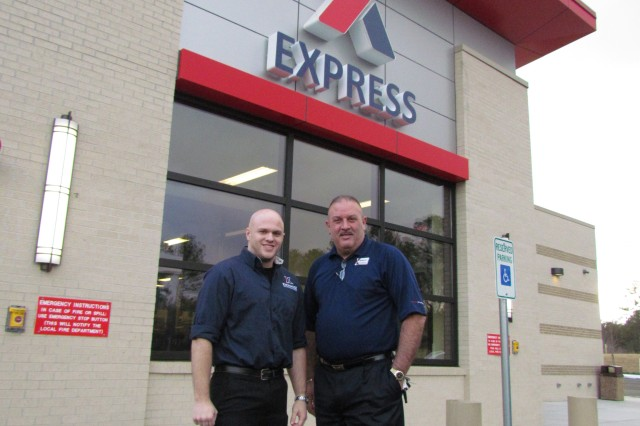 Express/Class 6 store manager John Wulff and Exchange general manager Roberto Montalvo are ready to greet customers with the grand opening of the Express convenience store and fast food shopping center. The store's official opening is Monday, with a ribbon cutting at 11 a.m.