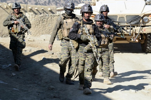 Village response unit, or VRU, members clear Oazai village in Sar Houzah district, Paktika Province, Afghanistan, Jan. 5, 2014. During the operation, the VRU detained one suspected insurgent before meeting with village elders.